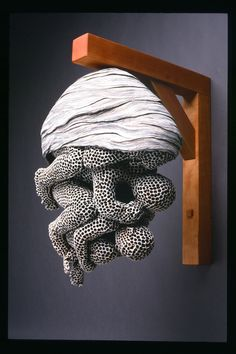 Adrian Arleo, Wasp Nest, Three Figures. 2004, clay, glaze, wood bracket, 16x13x8″