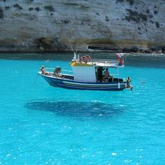 This Boat in clear water looks as if it floats in the air. Location is One House Bay, near the Island of Atokos, Greece. #Clear #Water #ClearWater #Boat #Floating #Beautiful #Natural #View #Atokos #Island #Greece