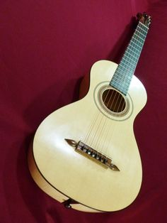 Early Guitar by Clive Titmuss modelled on Panormo 1809. $8,500.00, via Etsy.