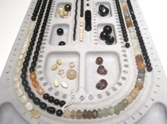 A set up for a long VN necklace for a glamorous lady in Paramaribo. Opaque moonstone in the shades of beige, grey and white as the main gemstone along with glass, ceramic and synthetic beads in various shapes and sizes.  In India moonstone is regarded as a sacred stone: it is believed to bring good fortune. Legend says that Moonstone is a highly prized gift for lovers as it arouses tender passion.   It sounds like a good deal to have good fortune and passion close to you :)