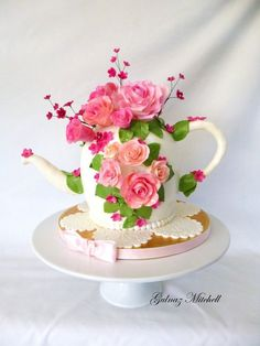 Vintage Teapot Cake with handmade sugar trinkets ~ The teacup, macarons, jam tarts, pearl necklace and flowers are all edible and made from fondant.
