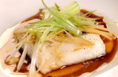Chinese New Year menu - Fish alternative: Steamed Cantonese-style fish - goodtoknow Ken Hom Recipes, Cod Recipes, Curry Recipes, Asian Recipes, Ethnic Recipes, Chinese Recipes, Shellfish Recipes, Seafood Recipes, Fish Dishes