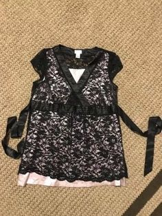 68e87ac61be90 Preworn Matherhood Maternity Blouse size large pink satin tank with lace  overlay And cute tie closure.