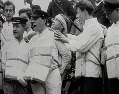 Some of the survivors of the Titanic's crew, still in their lifejackets, tell journalists their tales of that fateful journey.