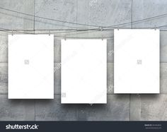 Three empty paper sheet frames hanged by pegs on blue metal sheet background