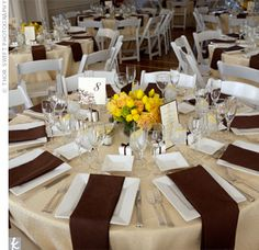 visual example of how we could do the colors: ivory table cloth, brown napkins, yellow flowers. for more visual impact, can do brown linens, ivory napkins and yellow flowers too.