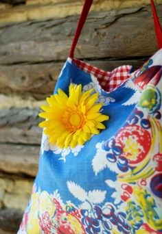 This sweet vintage upcycled tote is made from a gorgeous vintage fruity tablecloth remnant. The adorable design features a bright mixed fruit border with a beautiful sea blue center. It is lined with an adorable red and white gingham cotton fabric. There is a faux leather patch pocket on the insi...