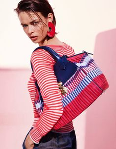 Giorgio Armani has unveiled its spring-summer 2016 campaign featuring model Birgit Kos. The model poses in sun-drenched images photographed by Solve Sundsbo wearing bold prints including stripes, circles and chevrons. For evening wear, Birgit oozes pure sophistication in a sparkling fringe adorned jacket and a navy blue gown with red detail. Giorgio Armani Spring 2016 …