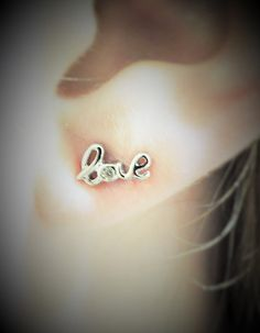 Tiny Cursive Sterling Silver Love Stud Earrings by Kissingravens