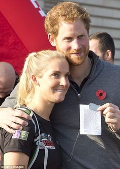 Embrace: Prince Harry hugged Afghan veteran Kirstie Ennis (pictured) as he welcomed home s...