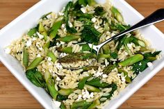 Lemon Orzo Salad with Asparagus, Spinach, and Feta --- Make sure not to over cook the spinach to retain it's color. Perfect to bring to a potluck as a side dish. Yummy warmed up or cold.
