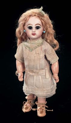 In the Mind's Eye - The Geri Baker Collection: 11 Petite French Bisque Bebe Jumeau,Size 1,with Original Wig
