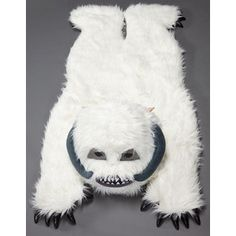 He's a huge Star Wars fan... I've already given him permission to have this Wampa rug in our house, in front of the fireplace of course.