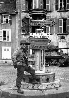 U.S. Army Signal Corps photographer Lt. Martin Lederhandler, attached to the 165th Signal Photographic Company with his 35mm Leica III camera somewhere in Germany, 1945.