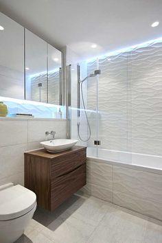 Exciting Tile Shower Corner Shelf with Floating Vanity Next to Wave Bathroom Tiles Alongside with Shower Tub Combo and Wave Tiles Bathroom Layout, Bathroom Colors, White Bathroom, Bathroom Interior, Bathroom Ideas, Bathroom Small, Bathroom Storage, 3d Tiles Bathroom, Colorful Bathroom