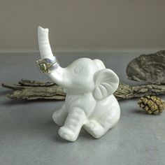 Elephant ring holder Lucky Elephant white jewelry Ceramic Ring Holder handmade pottery Elephant Decor unique gift for her under 25.  MADE TO ORDER ITEM - SEE SHIPPING & POLICIES TAB FOR PRODUCTION TIME  This sweet ceramic elephant Ring Holder, with its trunk upwards for luck, is 4 inches from bottom to top of trunk. Unglazed at the bottom and signed with blueroompottery.  The elephants trunk is upwards as a symbol of good luck, and the elephant itself symbolizes strength, wisdom, stabilit...