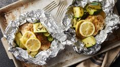 Lemon Chicken and Zucchini Foil Packs recipe and reviews - These quick and easy lemon chicken foil packs paired with zucchini, squash and thyme are a perfect summertime dinner.