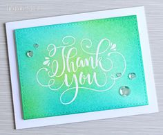 The Card Grotto: Thank You. I started out by cutting a piece of watercolour cardstock using the ME Femme Frame rectangle die. I then stamped the thank you with Versamark ink. I applied white embossing powder and heat set. I then blended over Distress Inks in Twisted Citron, Cracked Pistacio and Peacock Feathers.