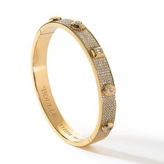 Bangle features bezel set fancy cut diamonds encrusted by brilliant pave diamonds on a lovely yellow gold bangle.