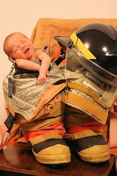 Firefighter baby omg that face :( too cute!