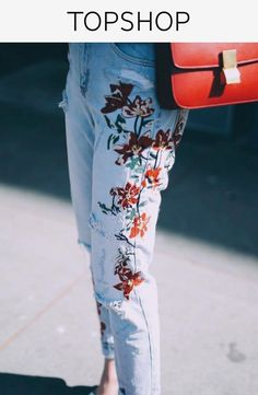 Off-duty styling never looked so good. Crafted from pure cotton, our MOTO Mom jeans come in an authentic rigid-look denim. Cut with a high-waist and a tapered leg, they are finished with multiple pockets, classic trims and floral embroidered detail. Wear them folded at the cuffs to keep them looking cool.