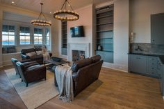 Family room built in bookcase. Family room bookcases and wet bar. Florida Homes Exterior, Luxury Homes Exterior, Limestone Countertops, Apron Front Kitchen Sink, Waterfront Homes For Sale, Florida Design, Dining Chair Slipcovers, Built In Bookcase, Floor To Ceiling Windows