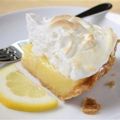 Grandma's Lemon Meringue Pie Recipe and Video - Fresh lemon juice and lemon zest make this lemon meringue pie filling tart and lovely. And when it's poured into a waiting crust, topped with billows of meringue, and baked, it's downright dreamy. Potluck Desserts, Lemon Desserts, Lemon Recipes, Pie Recipes, Just Desserts, Delicious Desserts, Dessert Recipes, Cooking Recipes, Recipies