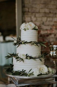 Publix wedding cake with green garnishes. #weddingcake #weddingphotography  wedding inspiration wedding ideas  wedding cakes wedding cake pictures