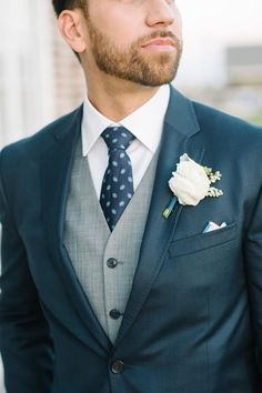 Charleston groom, navy suit, gray vest, white boutonniere // Aaron and Jillian Photography