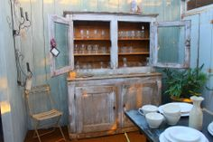 Shabby Chic dresser against a faded wall. White ware and  old chair. - http://www.balletpumpsandroses.com