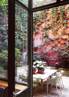 Surrounded by garden and sunlight.   I am often fascinated by the way in which those who have apartments, townhomes, and lofts create b...