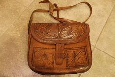 vintage cognac brown hand tooled leather purse // floral design // flap closure // by btdrvintage, $35.00