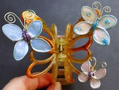Make your own butterfly hair clip using wire, glue and nail polish. It is so much fun. The tutorial has lots of tips and trick to make this project easy. Check it out so you can make one too. http://youtu.be/9mR0Zhx1S1I