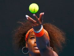 Serena Williams of the U.S. serves to Garbine Muguruza of Spain during their women's singles match at the Australian Open tennis tournament ...