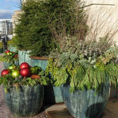 What do you do with your empty pots in the winter? Evergreen boughs, pinecones, and large, colorful ornaments. LOVE IT!