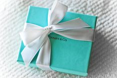 If you are trying to impress any female in your life, this iconic jewelry box packaging says it all, even before you have opened it. Tiffany And Co. has created the ultimate gift status symbol with their series of blue boxes. The packaging represents a gift that is just a 'bit more special' than all the rest and if you have every received one, you likely still have the box sitting in your closet or dresser drawer, reminding you of that special moment when you received a gift from a loved…