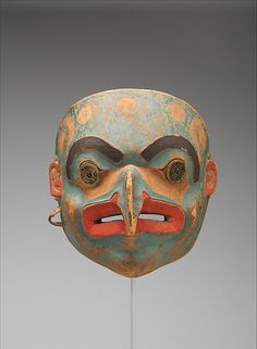 Transformation Mask  Date: 1820–30 / Geography: United States, Alaska, Culture: Tlingit  Medium: Wood, paint, metal coins, native-tanned skin