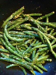 green beans in an iron skillet seasoned with onion and bacon