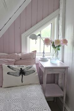 I really love the dragonfly pillow in this little cottage bedroom.