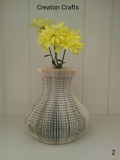 Book Art Vases that actually holds water! Available from http://www.creatoncraftsandgifts.co.uk/shop/book-art/book-art-vase/