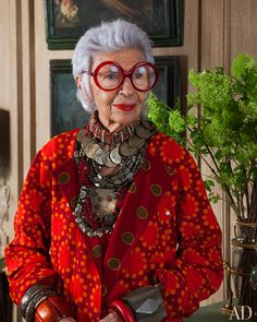 "Iconic Iris in red. ""When you don't dress like anyone else, you don't have to think like anyone else."""