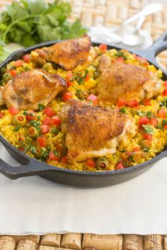 Spanish Chicken with Rice - Also known as Arroz con Pollo. A complete meal in just one pot! Elegant enough for company, easy enough for a busy weeknight!