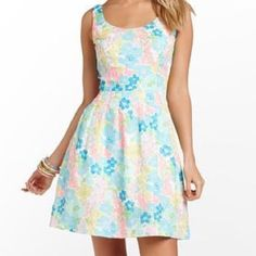 Lilly Pulitzer Serena floral This Lilly Pulitzer is stunning!!! It features a zip up the back, fully lined with petticoat style for a full skirt effect, tuck pleated waist, tank bodice and in a gorgeous bright floral print. Lilly Pulitzer Dresses