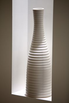 Unique vases bring personality to a space, this white on white example can be just as creative as a colour splash