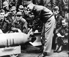 U.S. Army Air Corps Maj. Gen. James Doolittle fastens a medal on the tail of a 500-lb. bomb that he and the crew of sixteen B-25s dropped on Tokyo during a suprise raid on April 18, 1942. Doolittle and his crews' attack shocked the Japanese military establishment at a time when the Allies war effort in the Pacific seemed to be bad news following bad news from Bataan to Wake Island. (AP Photo/File)