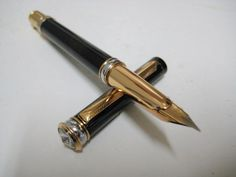 Grand Black and Gold Art Deco Fountain Pen Z582.  Magnificent black body with subtle gold tempering offset with gold and sliver coloured bands. The section is gold tinted with a hint of rose and a unique art deco style nib, fine writing.    The bladder in system is protected a steel casing and take ink from a bottle.     8edwin.com.au
