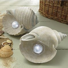 Bring a bit of ocean magic to your outdoor décor. These seashell lights have a natural painted finish washed with ocean blue