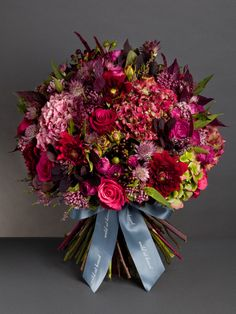 Red Sky at Night Bouquet  This luxurious, deeply coloured bouquet is made up of cheerio roses, garden hydrangea, pink asclepias, cotinus foliage, black hypericum berries, black dahlias and pink astrantia.  From £75  http://wildatheart.com/seasonal-favourites/red-sky-at-night.html
