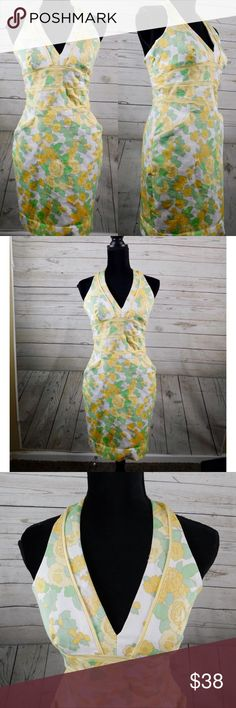 """Kay Unger Rockabilly Yellow Rose Halter Dress 10 Kay Unger stretch bodycon halter dress. Lined, has pockets. Rose pattern. Gently used condition. Slight faded spot near the front that blends with the print. (See last photo for more information) Size 10.  Approximate measurements lying flat: Chest: 15"""" Length: 27"""" (underarm to hem) B3 Kay Unger Dresses"""