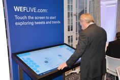 KPMG @ WEF 2015: Mark Goodburn, KPMG Global Head of Advisory, observing what's trending now on the WEFLIVE multi-touch screen #WEF15